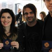The photographer didn't do such a great job of framing this one, but he at least got Emma and Shim (the Sick Puppies) holding CR beer koozies